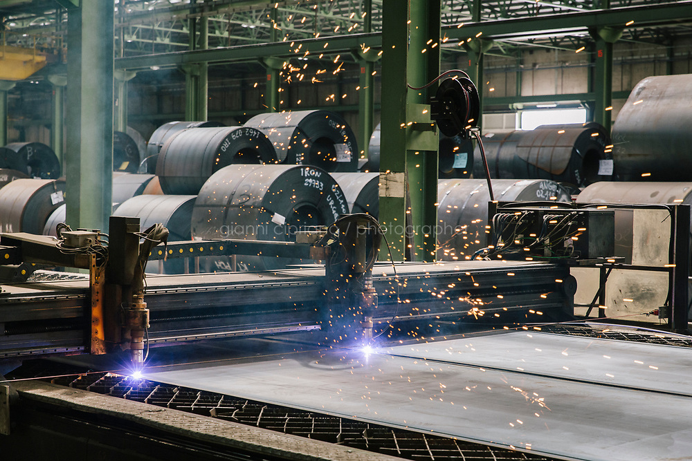 SANTA MARIA DEGLI ANGELI (ASSISI), ITALY - 11 JUNE 2018: A plasma cutting machine is seen here at work at the IRON S.p.A. factory, a publicly traded company that makes industrial steel parts, in Santa Maria degli Angeli (Assisi), Italy, on June 11th 2018.<br /> <br /> President Donald Trump&rsquo;s administration plans to impose tariffs on European steel and aluminum imports after failing to win concessions from the European Union, a move that could provoke retaliatory tariffs and inflame trans-Atlantic trade tensions. Until the moment that the American president rendered his decision, Mr. Capponi, the commercial director of IRON spa, was confident the continent would be spared.<br /> Given that IRON is a purchaser of steel, the company might benefit from the American tariffs. Steel now shipped to the United States from mills within Europe might stay here to avoid the tariffs, raising the supply and dropping prices. Chinese producers who export to American shores could divert their product to Europe, amplifying this trend.<br /> But Mr. Capponi was banking on none of this. Even if steel prices decline, his customers are likely to squeeze him for lower prices. More broadly, the American tariffs &mdash; justified by the Trump administration as a supposed defense of national security &mdash; reverberated as a blow against world trade.