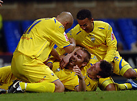 Photo: Ashley Pickering.<br />Ipswich Town v Preston North End. Coca Cola Championship. 17/10/2006.<br />Liam Chilvers (centre) is mobbed by team mates after scoring the equaliser for Preston