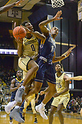 Vanderbilt Commodores guard Saben Lee (0) drives to the basket against Kent State Golden Flashes guard C.J. Williamson (1) during the first half of an NCAA basketball game in Nashville, Tenn., Friday, Nov. 23, 2018. (Jim Brown/IOS via AP)