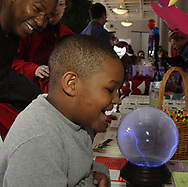 While his father Eric Sr. look on, Eric Devore, Jr., 5, from Huber Heights uses his voice to move some electricity in the Project Read booth during the 5th Annual TechFest at Sinclair Community College, Saturday afternoon.