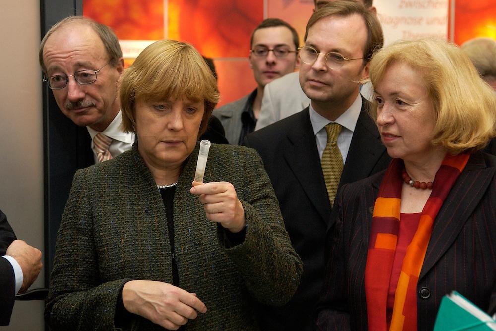 """25 OCT 2004, BERLIN/GERMANY:<br /> Helmut Heiderich, MdB, CDU, Gentechnikbeauftragter der CDU/CSU Bundestagsfraktion,, Angela Merkel, CDU Bundesvorsitzende, Thomas Rachel, MdB, CDU, und Maria Boehmer, CDU, Stellv. Fraktionsvorsitzende, (v.L.n.R.), betrachten ein Roehrchen,  Symposium der CDU/CSU Bundestagsfraktion """"Biotechnologie - Ernaehrung, Gesundheit, Medizin der Zukunft"""", CDU/CSU Fraktionssaal, deutscher Bundestag<br /> IMAGE: 20041025-02-009<br /> KEYWORDS: Reagenzglas, Röhrchen"""