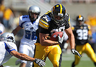 September 4 2010: Iowa Hawkeyes tight end Brad Herman (39) carries the ball during the first quarter of the NCAA football game between the Eastern Illinois Panthers and the Iowa Hawkeyes at Kinnick Stadium in Iowa City, Iowa on Saturday September 4, 2010. Iowa defeated Eastern Illinois 37-7.