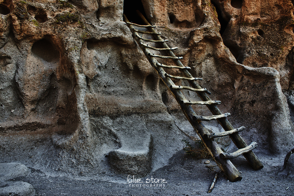A traditional handcrafted ladder at the entrance to the cliff dwellings used by Ancestral Pueblo peoples in the southwest represents a footprint of human presence.<br />