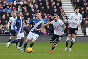 Derby County midfielder Bradley Johnson and Birmingham City FC midfielder Maikel Kieftenbeld challenge for the ball during the Sky Bet Championship match between Derby County and Birmingham City at the iPro Stadium, Derby, England on 16 January 2016. Photo by Aaron Lupton.