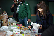 Junuko Sawada adds toppings to her ice cream at the International Student Union's Global Scoop event at Baker University Center during International Week at Ohio University on Tuesday, April 15, 2014.