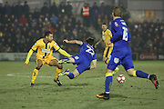 AFC Wimbledon defender Sean Kelly (22) getting fouled during the The FA Cup third round replay match between AFC Wimbledon and Sutton United at the Cherry Red Records Stadium, Kingston, England on 17 January 2017. Photo by Matthew Redman.