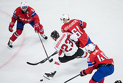 Simon Bodenmann vs Jonas Holos of Norway, Aleksander Reichenberg of Norway and Ken Andre Olimb of Norway during the 2017 IIHF Men's World Championship group B Ice hockey match between National Teams of Norway and Switzerland, on May 7, 2017 in Accorhotels Arena in Paris, France. Photo by Vid Ponikvar / Sportida