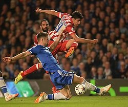30.04.2014, Stamford Bridge, London, ENG, UEFA CL, FC Chelsea vs Atletico Madrid, Halbfinale, Rueckspiel, im Bild Athletico Madrid's forward Diego Costa takes a shot at goal as Chelsea's defender Gary Cahill blocks the shot // Athletico Madrid's forward Diego Costa takes a shot at goal as Chelsea's defender Gary Cahill blocks the shot during the UEFA Champions League Round of 4, 2nd Leg Match between Chelsea FC and Club Atletico de Madrid at the Stamford Bridge in London, Great Britain on 2014/05/01. EXPA Pictures &copy; 2014, PhotoCredit: EXPA/ Mitchell Gunn<br /> <br /> *****ATTENTION - OUT of GBR*****
