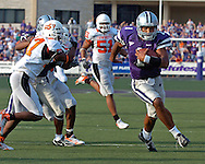 Kansas State quarterback Josh Freeman (1) rushes past Oklahoma State defensive back Jocob Lacey (17) for a 21-yard touchdown run with a minute left in the game, to give the Wildcats the lead at Bill Snyder Family Stadium in Manhattan, Kansas, October 7, 2006.  The Wildcats beat the Cowboys 31-27.<br />