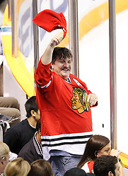 May 18, 2010; San Jose, CA, USA; A Chicago Blackhawks fan celebrates after left wing Andrew Ladd (not pictured) scored a goal against the San Jose Sharks during the first period of game two of the western conference finals of the 2010 Stanley Cup Playoffs at HP Pavilion.  The Blackhawks defeated the Sharks 4-2. Mandatory Credit: Jason O. Watson / US PRESSWIRE