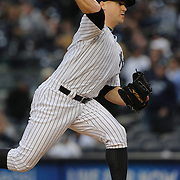 Pitcher Shawn Kelly closing the game for the New York Yankees during the New York Yankees V Baltimore Orioles home opening day at Yankee Stadium, The Bronx, New York. 7th April 2014. Photo Tim Clayton