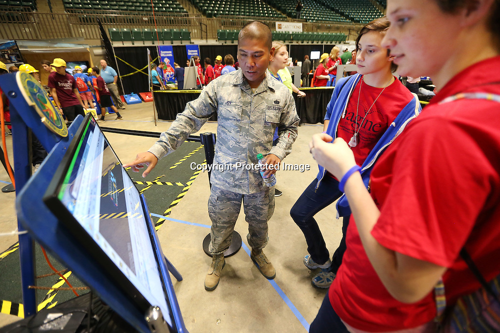 Adam Robison | BUY AT PHOTOS.DJOURNAL.COM<br /> Rodel Sy, Air Force Master Sergeant, uses a loading diagram of a C-17, to explain single load planning to Zadie Nixon, 14, and Cassandra Vaughn, 15, both students at Wheeler Attendance Center as they visit one of the Air Force booths at the Imagine the Possibilites Career Expo Wednesday morning in Tupelo.