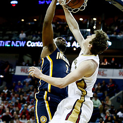 Dec 15, 2016; New Orleans, LA, USA; Indiana Pacers center Al Jefferson (7) dunks over New Orleans Pelicans center Omer Asik (3) during the first quarter of a game at the Smoothie King Center. Mandatory Credit: Derick E. Hingle-USA TODAY Sports