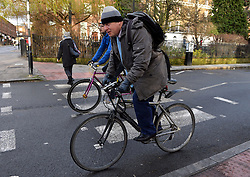 Mayor of London Boris Johnson leaves home on his bicycle after worker's strikes delay the opening of the tube service in London.<br /> Wednesday, 5th February 2014. Picture by Ben Stevens / i-Images