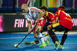 England's Nick Catlin is challenged by Alejandro De Frutos and Miquel Delas of Spain. England v Spain - Unibet EuroHockey Championships, Lee Valley Hockey & Tennis Centre, London, UK on 25 August 2015. Photo: Simon Parker