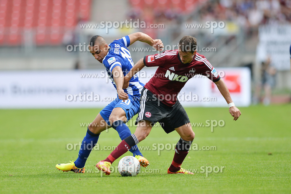 18.08.2013, easyCredit Stadion, Nuernberg, GER, 1. FBL, 1. FC Nuernberg vs Hertha BSC, 2. Runde, im Bild Aenis Ben-Hatira (Hertha BSC Berlin/ links) im Zweikampf mit Markus Feulner (1.FC Nuernberg/ rechts). Action / Aktion // during the German Bundesliga 2nd round match between 1. FC Nuernberg and Hertha BSC at the easyCredit Stadium, Nuernberg, Germany on 2013/08/18. EXPA Pictures &copy; 2013, PhotoCredit: EXPA/ Eibner/ Matthias Merz<br /> <br /> ***** ATTENTION - OUT OF GER *****