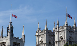 © Licensed to London News Pictures. 02/07/2015. London, UK. The Union Flags above Westminster Abbey (right) and St Margaret's Church are flying at half mast today in memory of the 30 British tourists that died in the terrorist attack in Sousse, Tunisia last week. Photo credit : James Gourley/LNP