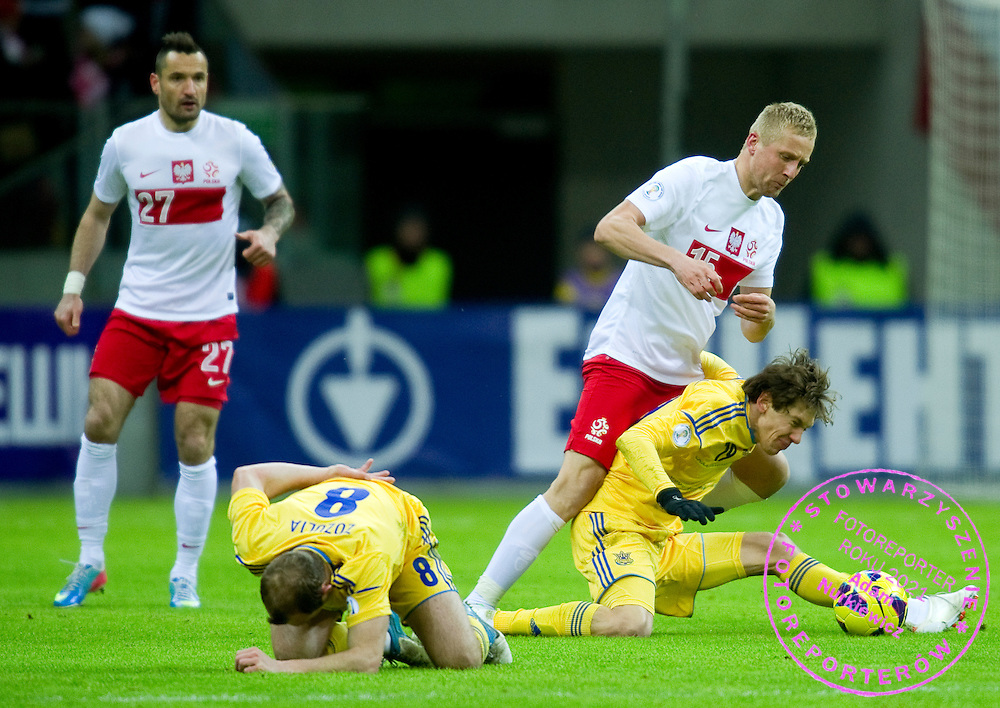 (2R) Kamil Glik of Poland fights for the ball with (R) Denys Harmasz of Ukraine during the 2014 World Cup Qualifying Group H soccer match between Poland and Ukraine at National Stadium in Warsaw on March 22, 2013...Poland, Warsaw, March 22, 2013...Picture also available in RAW (NEF) or TIFF format on special request...For editorial use only. Any commercial or promotional use requires permission...Photo by © Adam Nurkiewicz / Mediasport