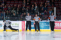 KELOWNA, CANADA - DECEMBER 8: Mike Langin, and Alex Teichroeb, linesmen, and Kevin Webinger and Reagan Vetter, referees stand on the ice as the Prince George Cougars visit the Kelowna Rockets on December 8, 2012 at Prospera Place in Kelowna, British Columbia, Canada (Photo by Marissa Baecker/Shoot the Breeze) *** Local Caption ***