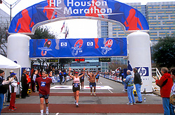 Stock photo of competitors crossing the finish line
