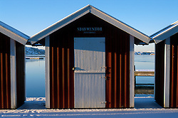 SWEDEN FJALLBACKA JAN04 - Wooden sheds in the snow in Fjallbacka harbour.. . jre/Photo by Jiri Rezac. . © Jiri Rezac 2004. . Contact: +44 (0) 7050 110 417. Mobile:  +44 (0) 7801 337 683. Office:  +44 (0) 20 8968 9635. . Email:   jiri@jirirezac.com. Web:    www.jirirezac.com.