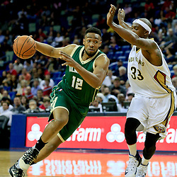 Nov 1, 2016; New Orleans, LA, USA; Milwaukee Bucks forward Jabari Parker (12) drives past New Orleans Pelicans forward Dante Cunningham (33) during the first quarter of a game at the Smoothie King Center. Mandatory Credit: Derick E. Hingle-USA TODAY Sports