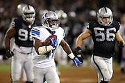 Detroit Lions running back Theo Riddick (41) runs with the ball after catching a third quarter pass good for a gain of 36 yards to the Oakland Raiders 16 yard line during the 2014 NFL preseason football game against the Oakland Raiders on Friday, Aug. 15, 2014 in Oakland, Calif. The Raiders won the game 27-26. ©Paul Anthony Spinelli