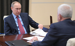 April 13, 2017 - Moscow Region, Russia - April 13, 2017. - Russia, Moscow Region, Novo-Ogaryovo. - Russian President Vladimir Putin and Vagit Alekperov, President of Lukoil, (right) at a meeting. (Credit Image: © Russian Look via ZUMA Wire)
