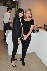 Left to right, CLAUDIA WINKLEMAN and ELISABETH MURDOCH at a dinner in aid The Journalism Foundation held at Philips De Pury & Company, Howick Place, London, SW1 on 22nd May 2012.