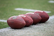 NFL footballs are lined up and ready for use during pre game warmups before the Arizona Cardinals 2014 NFL preseason football game against the Houston Texans on Saturday, Aug. 9, 2014 in Glendale, Ariz. The Cardinals won the game in a 32-0 shutout. ©Paul Anthony Spinelli