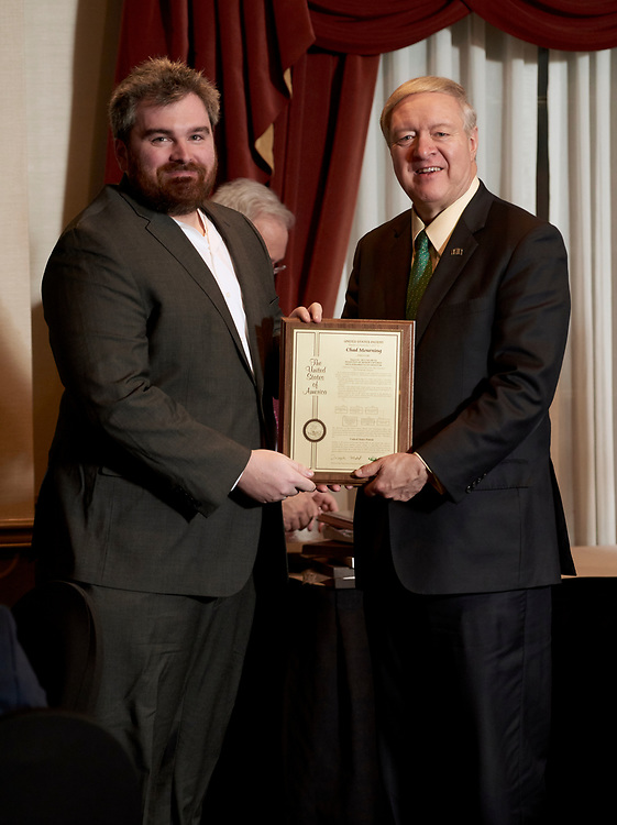 President Nellis presents Chad Mourning his patent award.