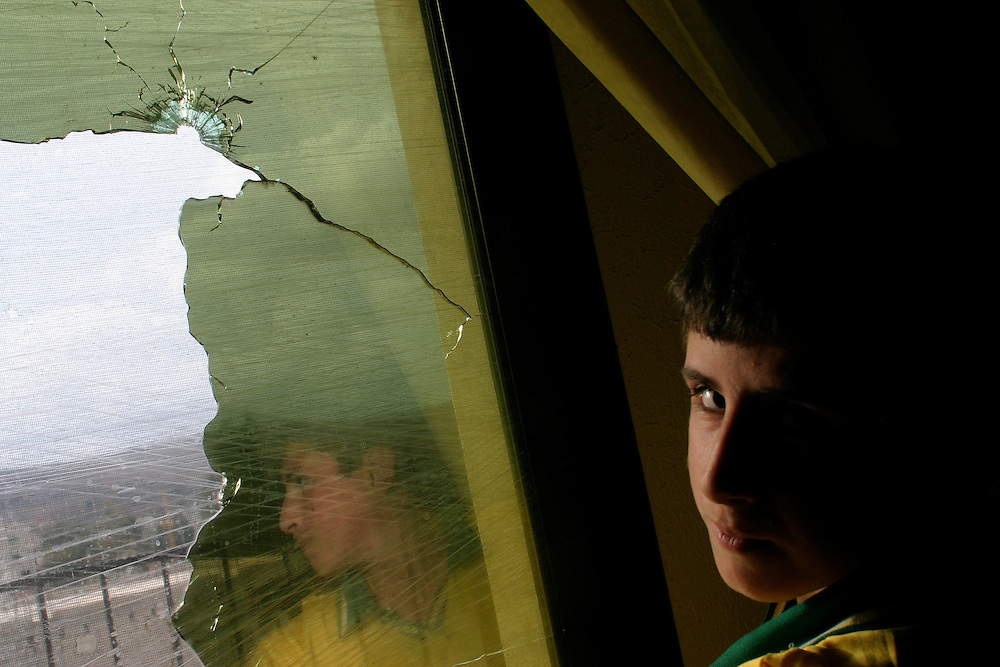 Hussein, 11, at his best friend's home in Aitaroun, south Lebanon.