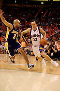 May 25, 2010; Phoenix, AZ, USA; Phoenix Suns guard Steve Nash (13) drives the ball against Los Angeles Lakers guard Derek Fisher (2) during the first quarter in game four of the western conference finals in the 2010 NBA Playoffs at US Airways Center.  Mandatory Credit: Jennifer Stewart-US PRESSWIRE