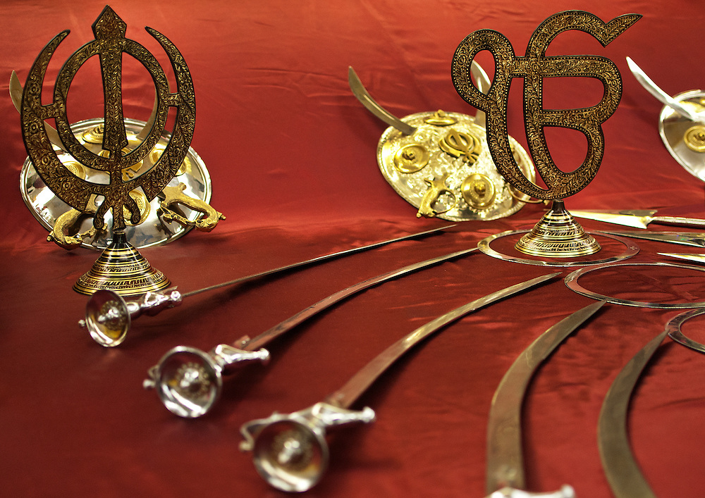 The Khanda, a religious symbol of Sikhism, has a sword and two swords (spiritual and temporal powers).