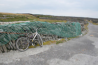 Fishing news drying on stone wall Inis Oirr the Aran Islands Galway Ireland