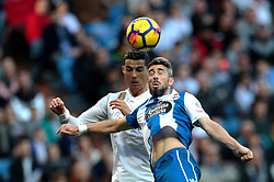 MADRID, Jan. 22, 2018  Real Madrid's Cristiano Ronaldo (L) vies with La Coruna's Luisinho during a Spanish league match between Real Madrid and Deportivo de la Coruna in Madrid, Spain, on Jan. 21, 2018. Real Madrid won 7-1. (Credit Image: © Juan Carlos/Xinhua via ZUMA Wire)