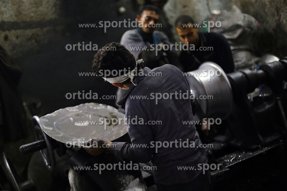 Egyptian workers make aluminous cooking pots at a local factory in Mit Ghamr of Dakahlia, 150 km north of Cairo, Egypt, on March 13, 2016. There are about 1,500 aluminous product factories in Mit Ghamr with over 80,000 workers employed. These factories produce over 80% of Egypt's domestic aluminous products and many of the products are exported to other African countries. EXPA Pictures &copy; 2016, PhotoCredit: EXPA/ Photoshot/ Ahmed Gomaa<br /> <br /> *****ATTENTION - for AUT, SLO, CRO, SRB, BIH, MAZ, SUI only*****