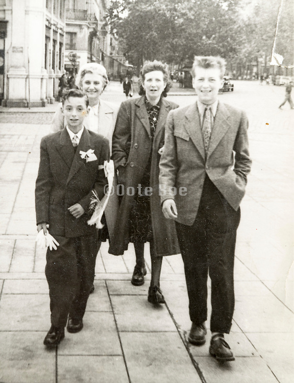 family and friend walking with son for his holy communion France 1950s