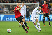 Ander Herrera of Manchester United gets away from Roque Mesa of Swansea City during the EFL Cup match between Swansea City and Manchester United at the Liberty Stadium, Swansea, Wales on 24 October 2017. Photo by Andrew Lewis.