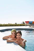 Two teenage girls (16-17) in swimming pool portrait
