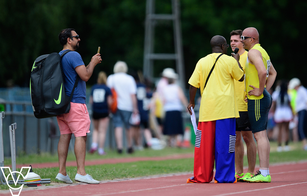Metro Blind Sport's 2017 Athletics Open held at Mile End Stadium.  100m.  Amir Kamali-Sarvestani with volunteer talking to the crowd <br /> <br /> Picture: Chris Vaughan Photography for Metro Blind Sport<br /> Date: June 17, 2017