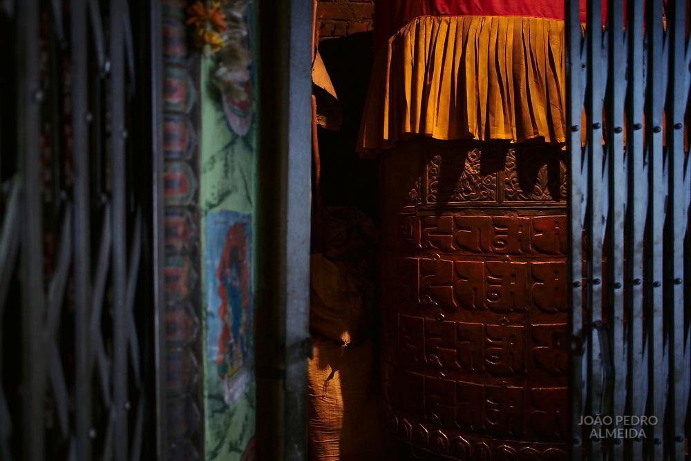 Prayer wheels inside Buddhist temple.
