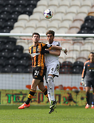 Hull's Shane Long in an aerial duel with Swansea' Chico Flores - Photo mandatory by-line: Matt Bunn/JMP - Tel: Mobile: 07966 386802 05/04/2014 - SPORT - FOOTBALL - KC Stadium - Hull - Hull City v Swansea City- Barclays Premiership