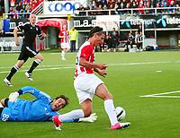 Tromsø 20120823 EUROPA LEAGUE. Tromsø IL - Partizan Beograd, Alfheim Stadion, Tromsø.<br /> Aleksandar Prijovic runder keeper Stojkovic Vladimir