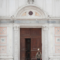 VENICE, ITALY - FEBRUARY 12:  A man places old carpets in front of a church steps to avoid falls due to ice and snow on February 12, 2012 in Venice, Italy. Italy, like most of Europe, is experiencing freezing temperatures, with the Venice Lagoon freeezing for the first time in over 20 years.