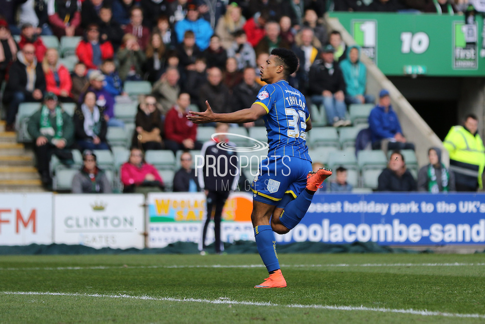 Lyle Taylor forward for AFC Wimbledon (33) scores to make it 0-1 during the Sky Bet League 2 match between Plymouth Argyle and AFC Wimbledon at Home Park, Plymouth, England on 9 April 2016. Photo by Stuart Butcher.