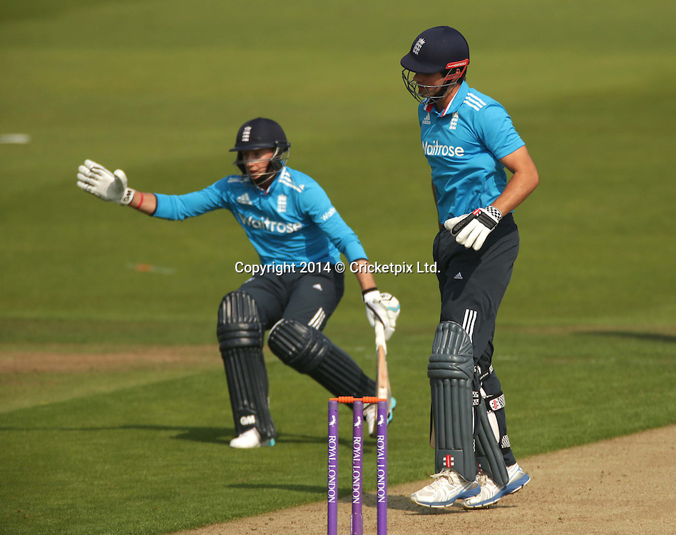 A mix-up between Alastair Cook (right) and Joe Root almost ends in a run out during the fifth and final Royal London One Day International between England and India at Headingley, Leeds. Photo: Graham Morris/www.cricketpix.com (Tel: +44 (0)20 8969 4192; Email: graham@cricketpix.com) 050914