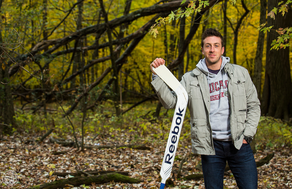 St. Louis Blues goalie prospect poses for a magazine portrait on October 28, 2013 in a forest near Chicago, IL. (Photograph ©Ross Dettman)
