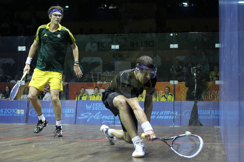 Cameron Pilley of Australia and Martin Knight of New Zealand during the final of the mixed doubles squash competition held at the Siri Fort Complex in New Delhi as part of the XIX Commonwealth Games, India on the 13 October 2010..Photo by:  Ron Gaunt/photosport.co.nz