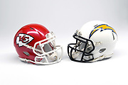 Detailed view of Kansas City Chiefs and Los Angeles Chargers helmets.